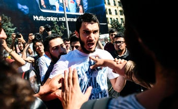 Turkish nationalists confront LGBT rights activist who are trying to go ahead with a Gay Pride annual parade in Istanbul, June 25, 2017.
