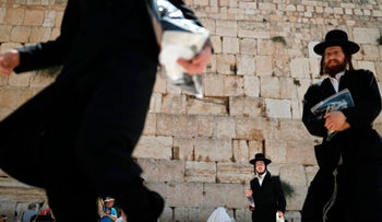 Ultra-Orthodox worshipers in the men's section at the Western Wall.
