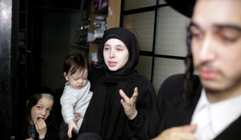 A woman, member of Lev Tahor, reacts after local police raided several of their homes while investigating allegations of child abuse, in Guatemala City, Guatemala, September 13, 2016.