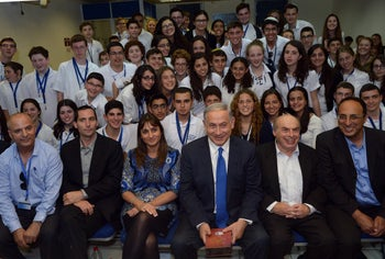 Prime Minister Benjamin Netanyahu with Jewish Agency head Natan Sharansky (to his right) at a Bible quiz event in April 2015.