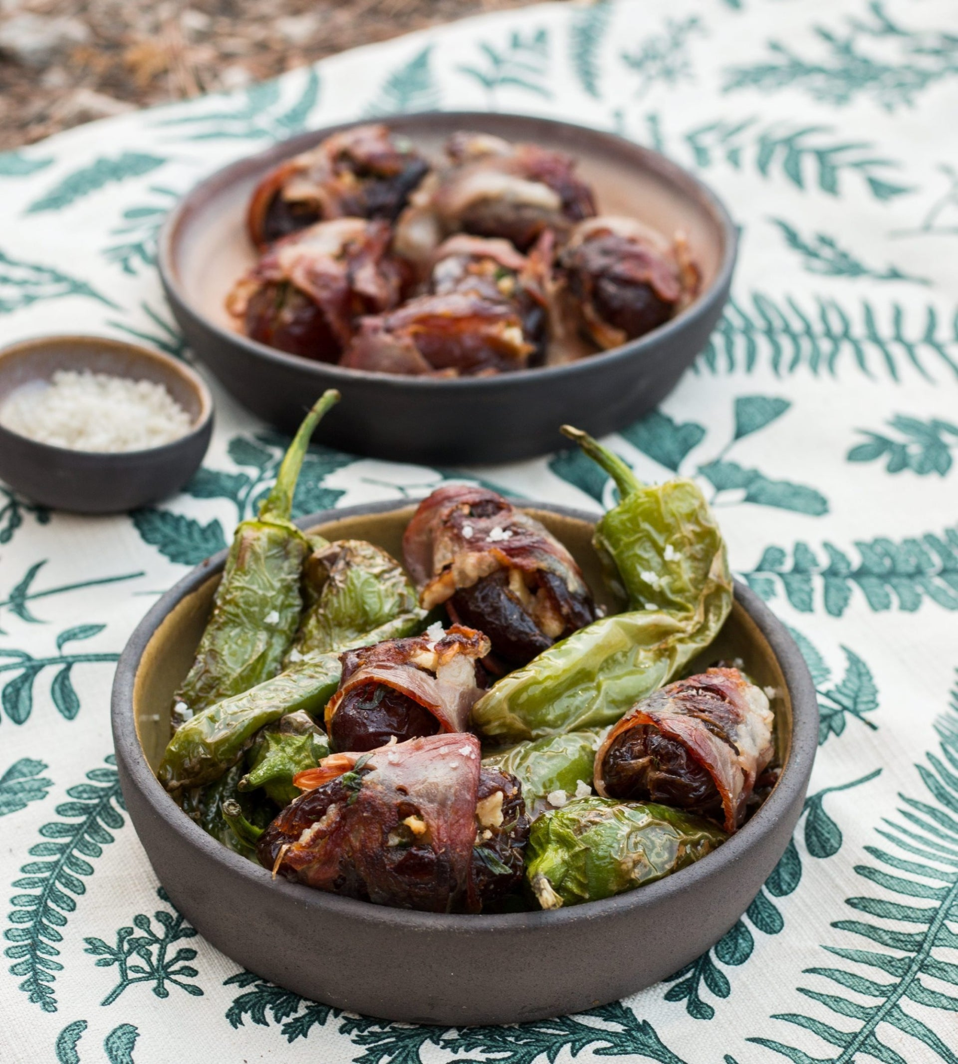 Dates wrapped in lamb bacon with Padron peppers. Sweet and calorie-rich.