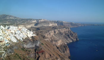 The view from the village of Fira along caldera wall to the south showing quaternary volcanic series, is pictured in this undated handout photo from the Greek Island of Santorini in the Aegean Sea. Photographer: Sturt Manning Source: Sturt Manning/Science via Bloomberg News