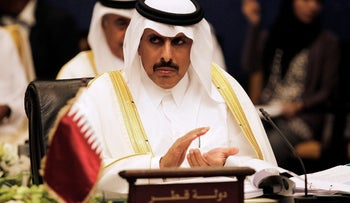 Qatar's central bank governor Sheikh Abdullah bin Saoud al-Thani claps during the 58th GCC Central Bank Governors' annual meeting in Manama September 18, 2013.