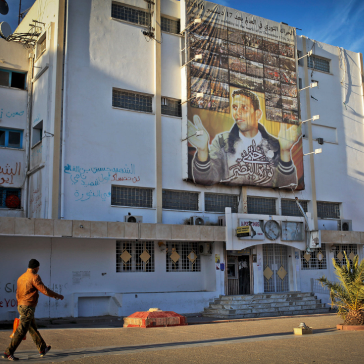 A poster of Mohamed Bouazizi, the fruit seller whose self-immolation set off the country's revolution in 2010, in Sidi Bouzid.
