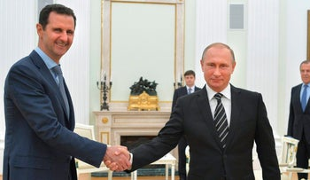 File photo: Russian President Vladimir Putin shakes hand with Syrian President Bashar Assad in the Kremlin in Moscow, Russia. Oct. 20, 2015.