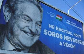 A poster with US billionaire George Soros is pictured on July 6, 2017