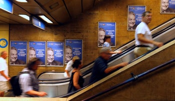Hungarian government posters on the Budapest underground portraying George Soros with the tagline: 'Don't let George Soros have the last laugh.' July 11, 2017.