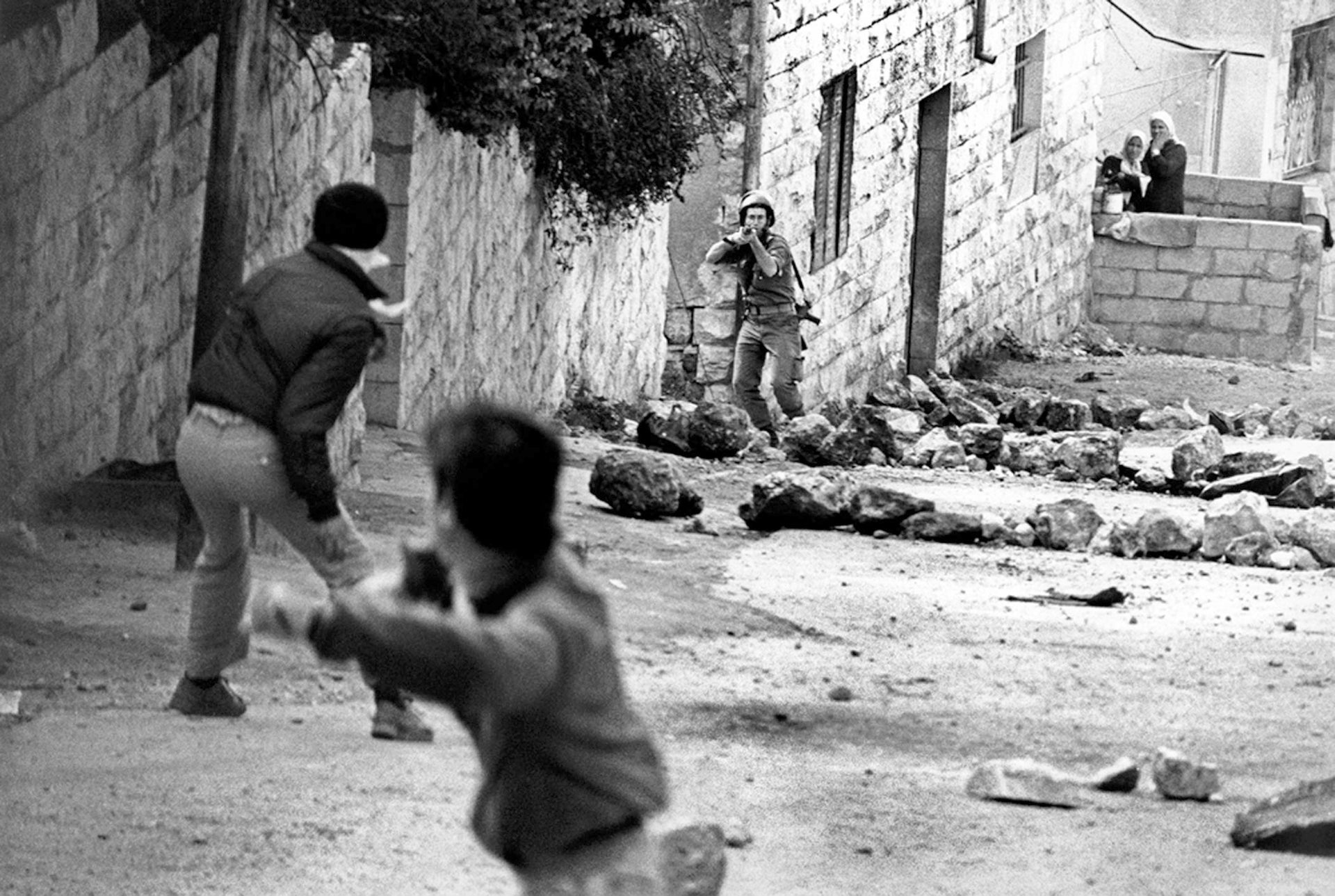 Palestinians throw rocks at Israeli troops in Anabta during the first intifada, 1989.