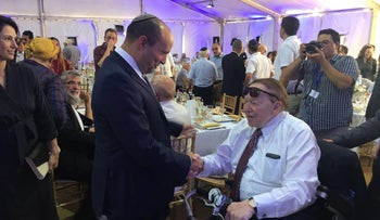 Naftali Bennett and Sheldon Adelson at the cornerstone laying for Ariel university's medical school, June 2017.