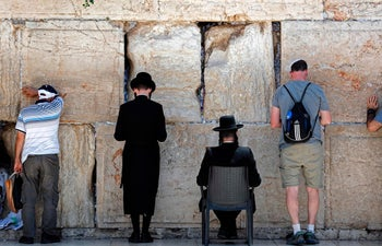 Jewish men pray at the men's section of the Western Wall, the most holy site where Jews can pray, in Jerusalem's Old City on June 27, 2017.