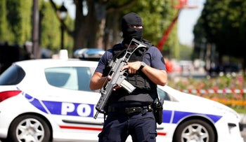 File photo: A masked French policeman secures the area on the Champs Elysees avenue after an incident in Paris, France, June 19, 2017
