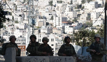 Israeli soldiers block the entrance to the Hebron's Jewish neighborhood, in the West Bank, September 18, 2016.
