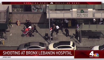 In this image taken from video provided by WNBC 4 New York, emergency personnel converge on Bronx Lebanon Hospital in New York, after a gunman opened fire there on Friday, June 30, 2017. (NBC 4 New York via AP)