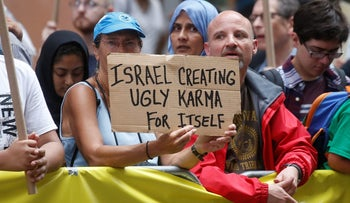 An anti Israel protester holds up a sign during a demonstration in Times Square in the Manhattan borough of New York City, New York, U.S. June 23, 2017.