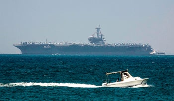 The aircraft carrier USS George H.W. Bush is seen moored in the Mediterranean Sea off the Israeli port of Haifa on July 1, 2017.