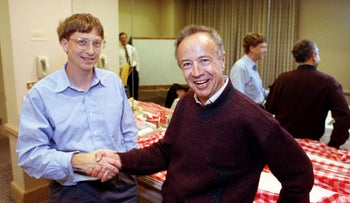 Intel Corp. President Andy Grove, right, shakes hands with Microsoft Chairman Bill Gates at a meeting in Burlingame, Calif., in 1992.