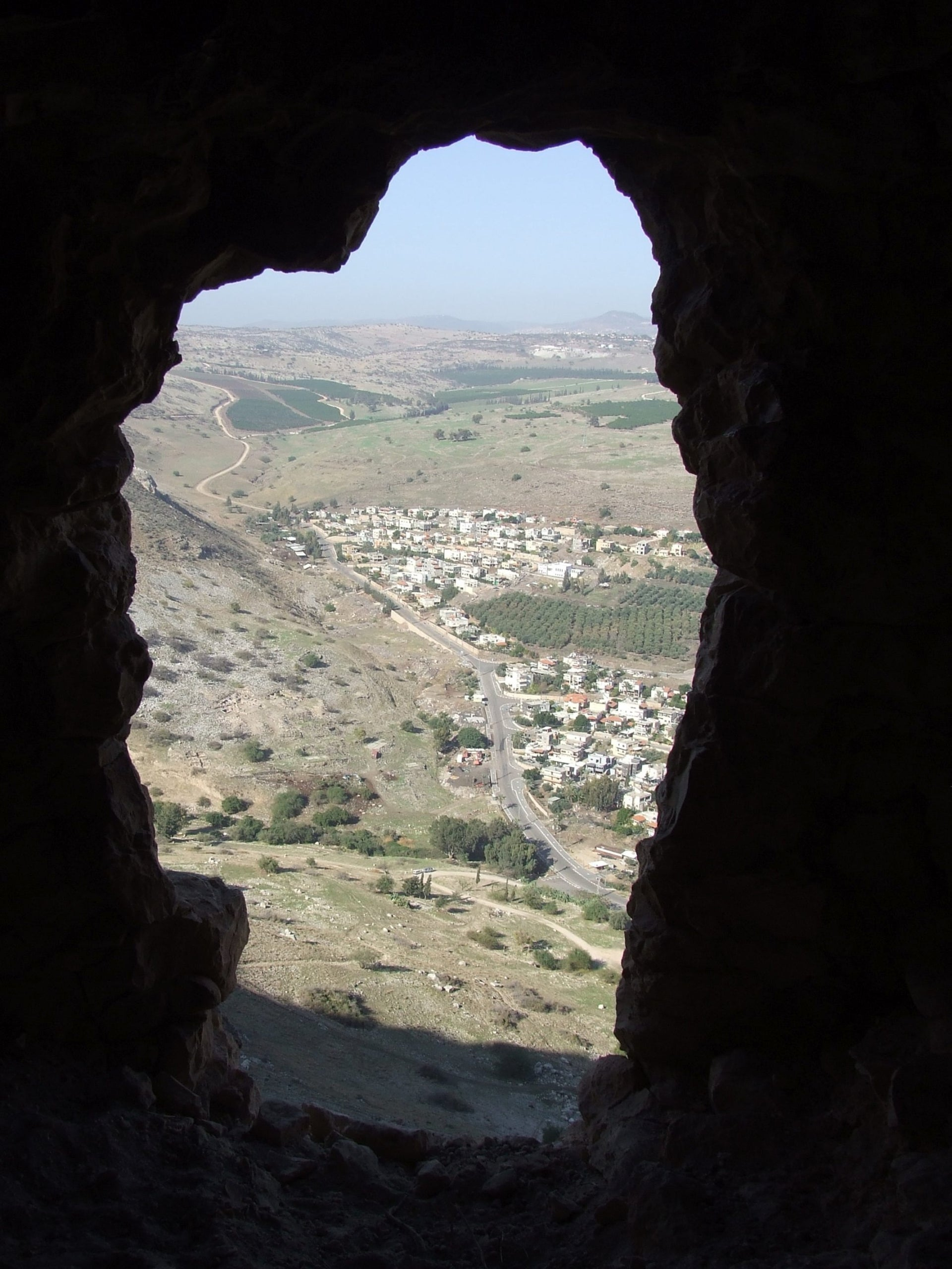 Looking down at the town of Migdal from one of the cliffside caves in which Jewish rebels hid from the Roman forces during the First Jewish War, some 2000 years ago.