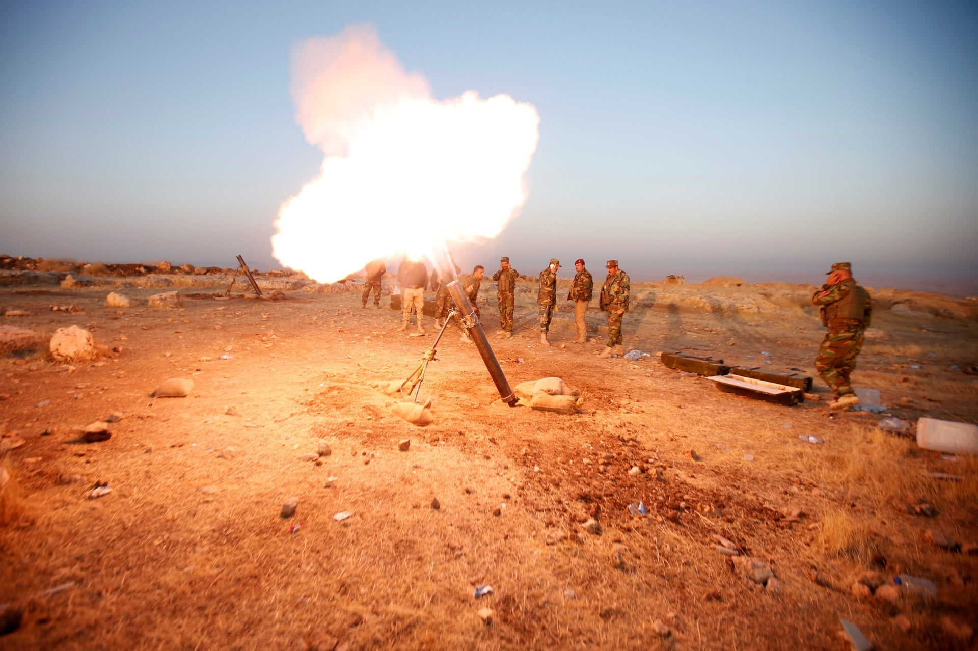 Peshmerga forces fires a mortar towards Islamic state militants' positions in the town of Naweran, near Mosul, October 23, 2016.