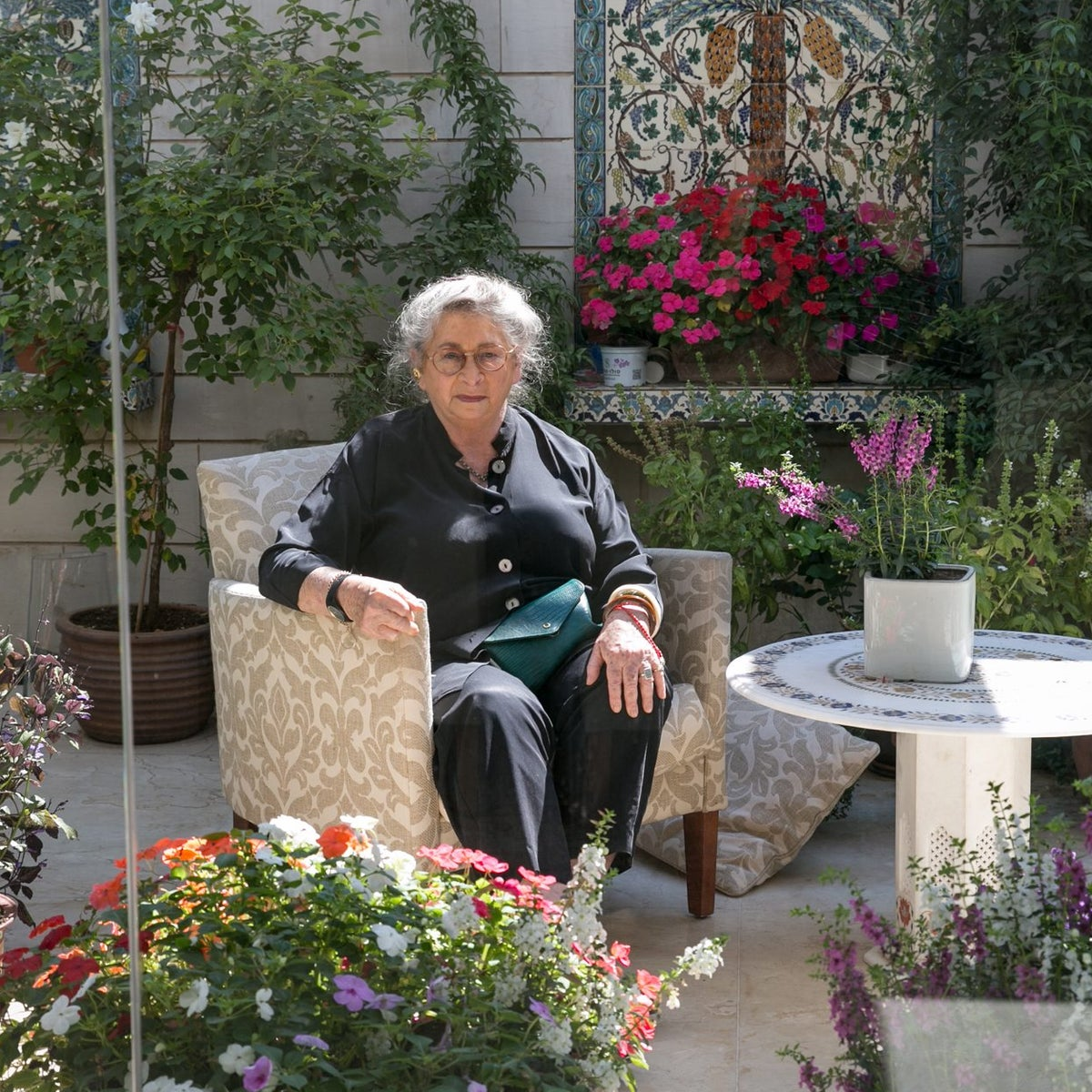 First Lady Nechama Rivlin sits in the garden of the the president's residence in Jerusalem, September 2016.