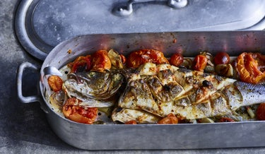 Baked fish with white wine and tomatoes.