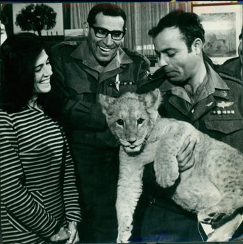 Rehavam Ze'evi with the lioness he held at an Israeli army base.