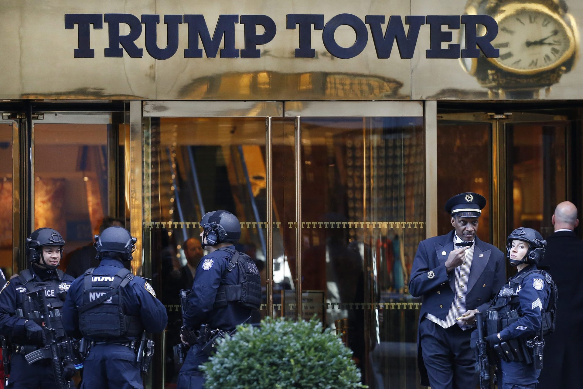 Members of the New York Police Department's counterterrorism unit guard Trump Tower, Monday, Nov. 14, 2016. President-elect Donald Trump is making an overture to warring Republican circles by appointing GOP chief Reince Priebus as his White House chief of staff and Breitbart News executive Stephen Bannon as chief strategist and senior counselor.