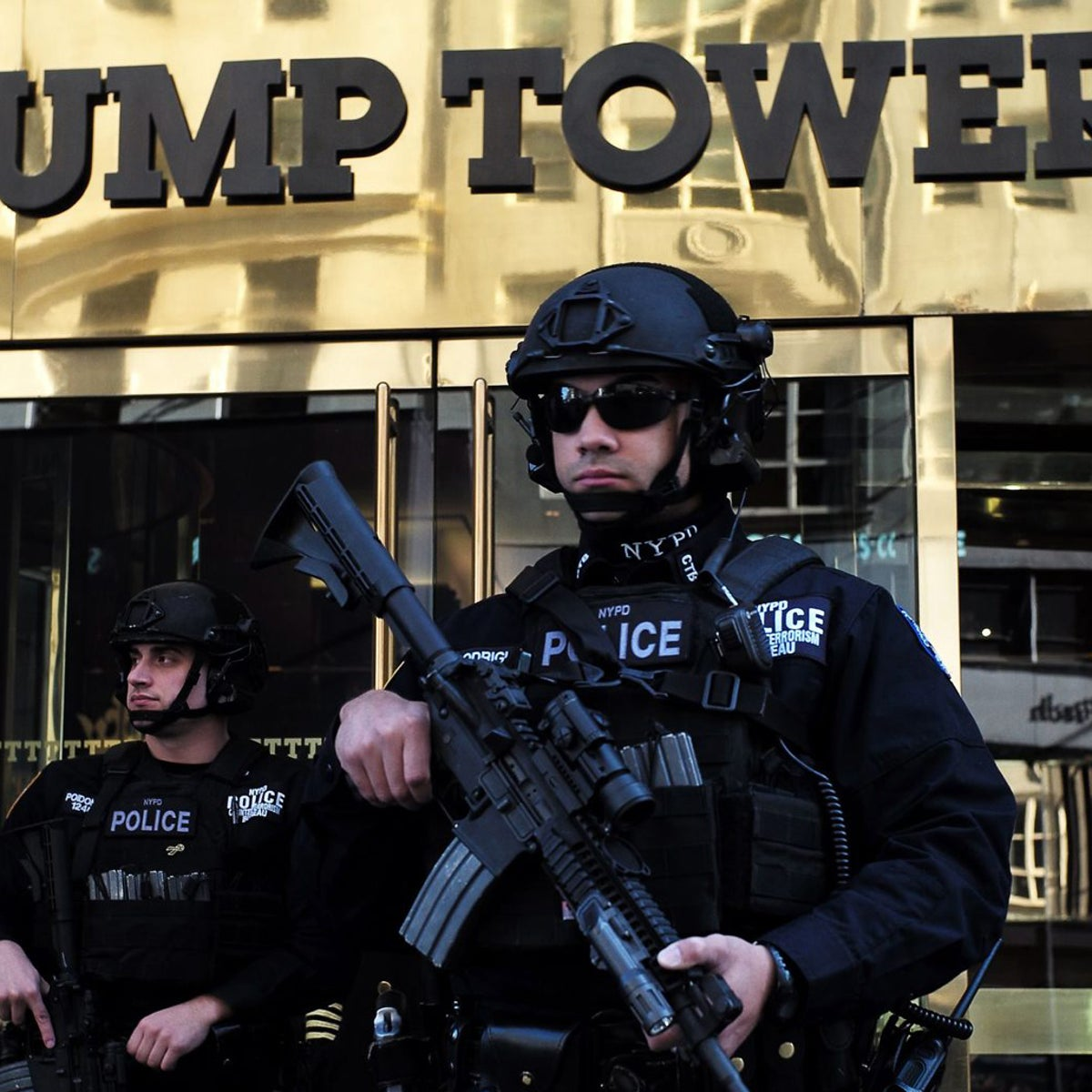 New York Police Department (NYPD) officers guard the main entrance of the Trump Tower, where US President-elect Donald Trump holds meetings, in New York on November 14, 2016.  President-elect Donald Trump has vowed to move aggressively on a conservative agenda in filling Supreme Court vacancies, cracking down on immigration and cutting taxes, but also sought to reassure worried Americans they have nothing to fear from his presidency.