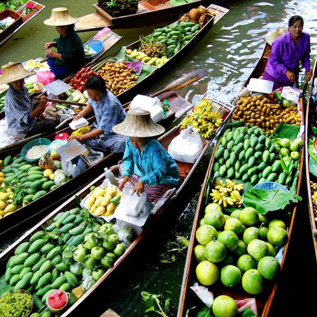 Boats at a produce market in Thailand