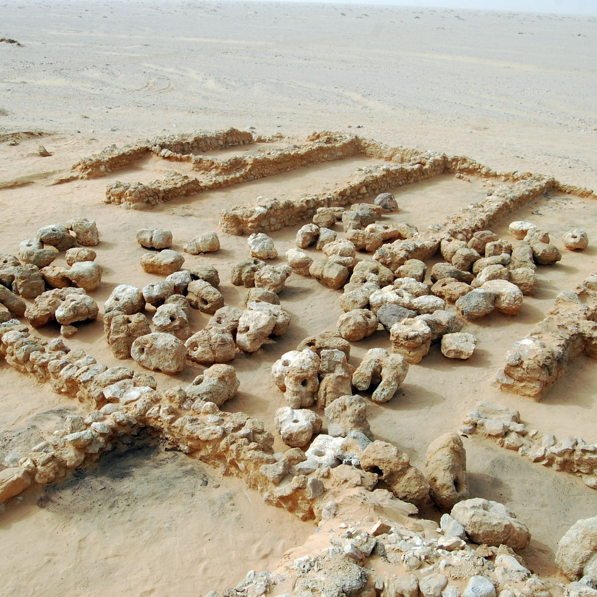 Remains of the harbor structure by the Red Sea and the anchor deposits, near Wadi el-Jarf. The harbor was built by King Cheops to import materials for the construction of the Great Pyramid of Giza.