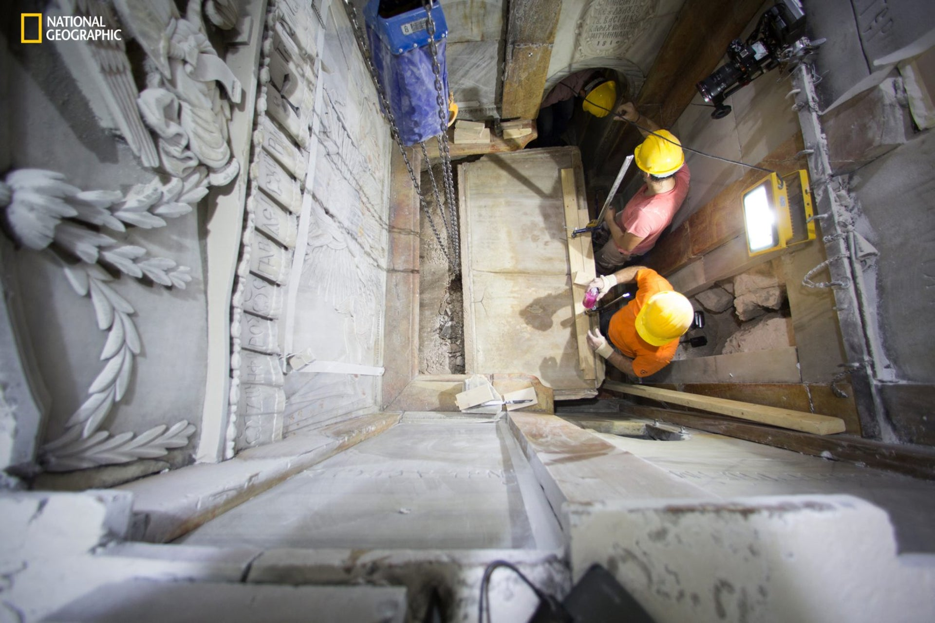 Workers replace the marble slab covering the Tomb of Jesus, where his body is believed to have been laid: the stone had been removed for 3 days to allow the team to do restoration works.