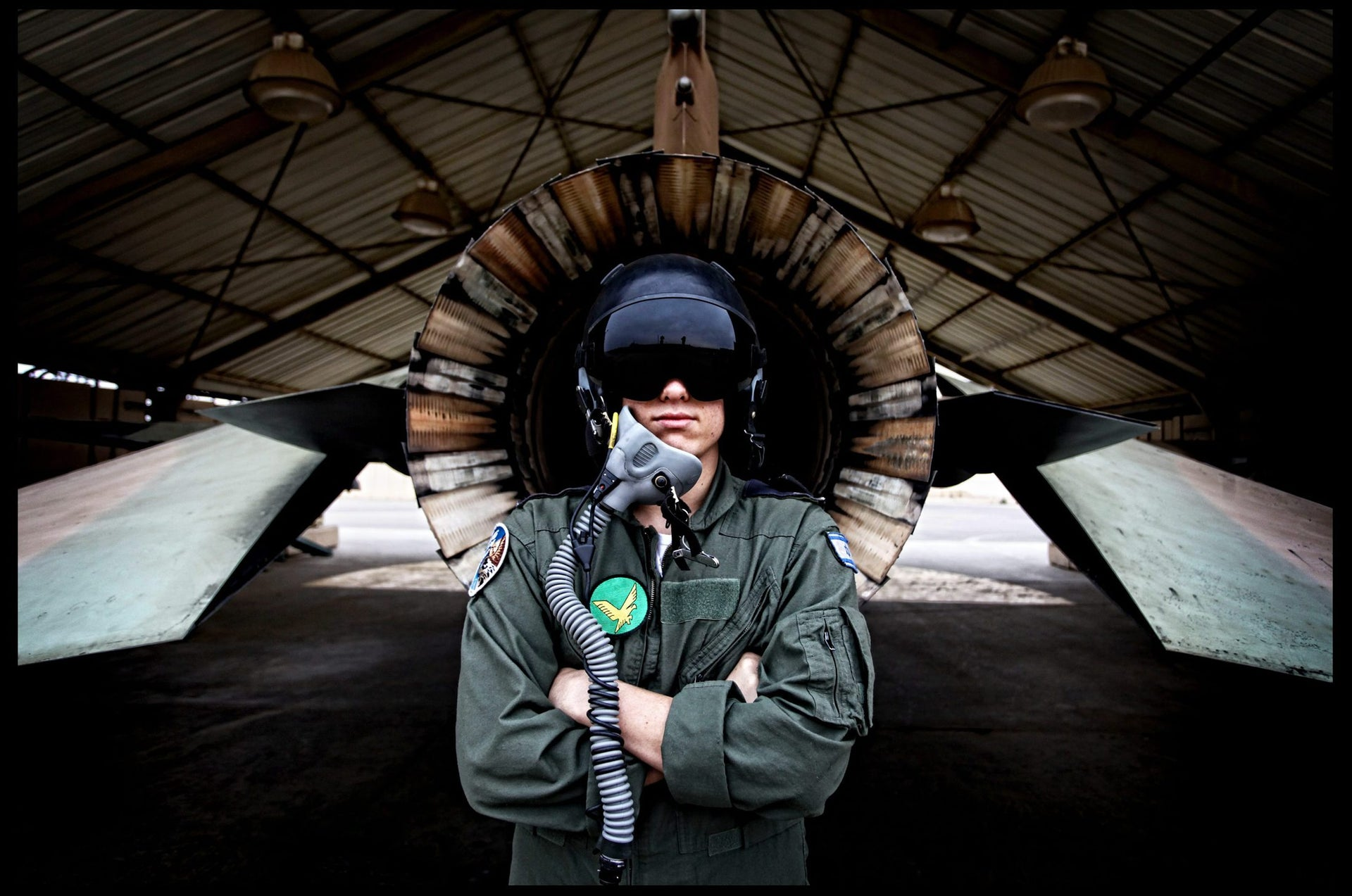 """A pilot stands in front of the F-16 """"Netz"""" (Hawk) fighter plane at the Nevatim base in 2011."""