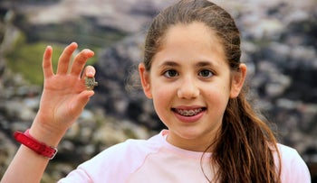 Neshama Spielman with the ancient Egyptian amulet in Jerusalem on April 19, 2016.