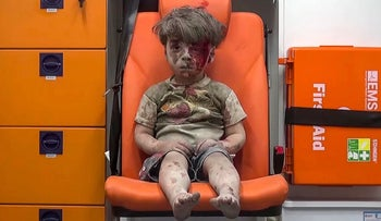 A child sits in an ambulance in Aleppo, Syria, after an airstrike, August 2016