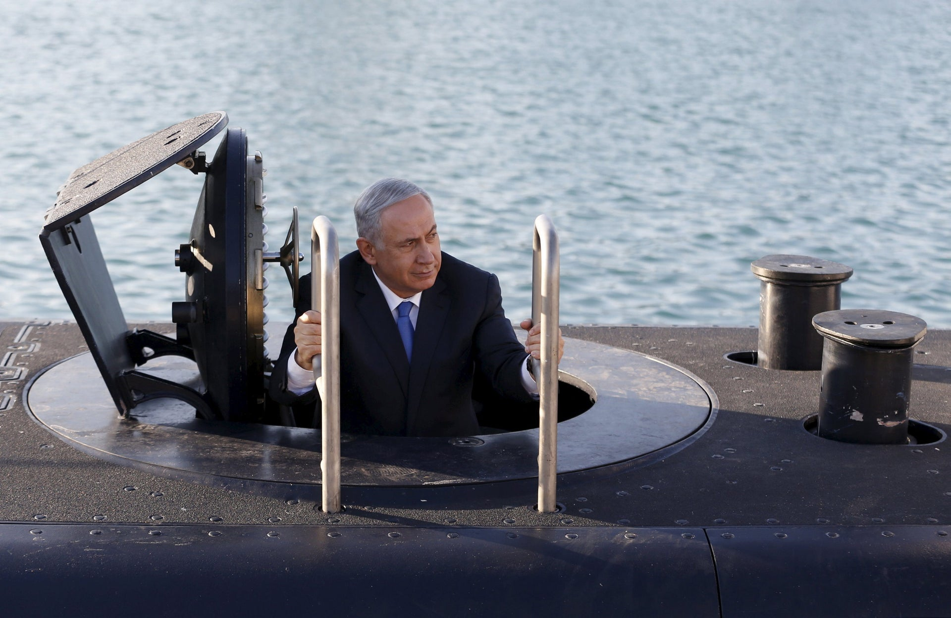 Prime Minister Benjamin Netanyahu climbs out of the Rahav, a submarine widely believed to be capable of firing nuclear missiles, Haifa, Israel, January 12, 2016.