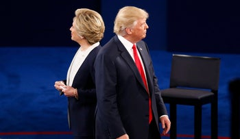 Hillary Clinton, 2016 Democratic presidential nominee, and Donald Trump, 2016 Republican presidential nominee, stand on stage during the second U.S. presidential debate at Washington University in St. Louis, Missouri, U.S., on Sunday, Oct. 9, 2016.