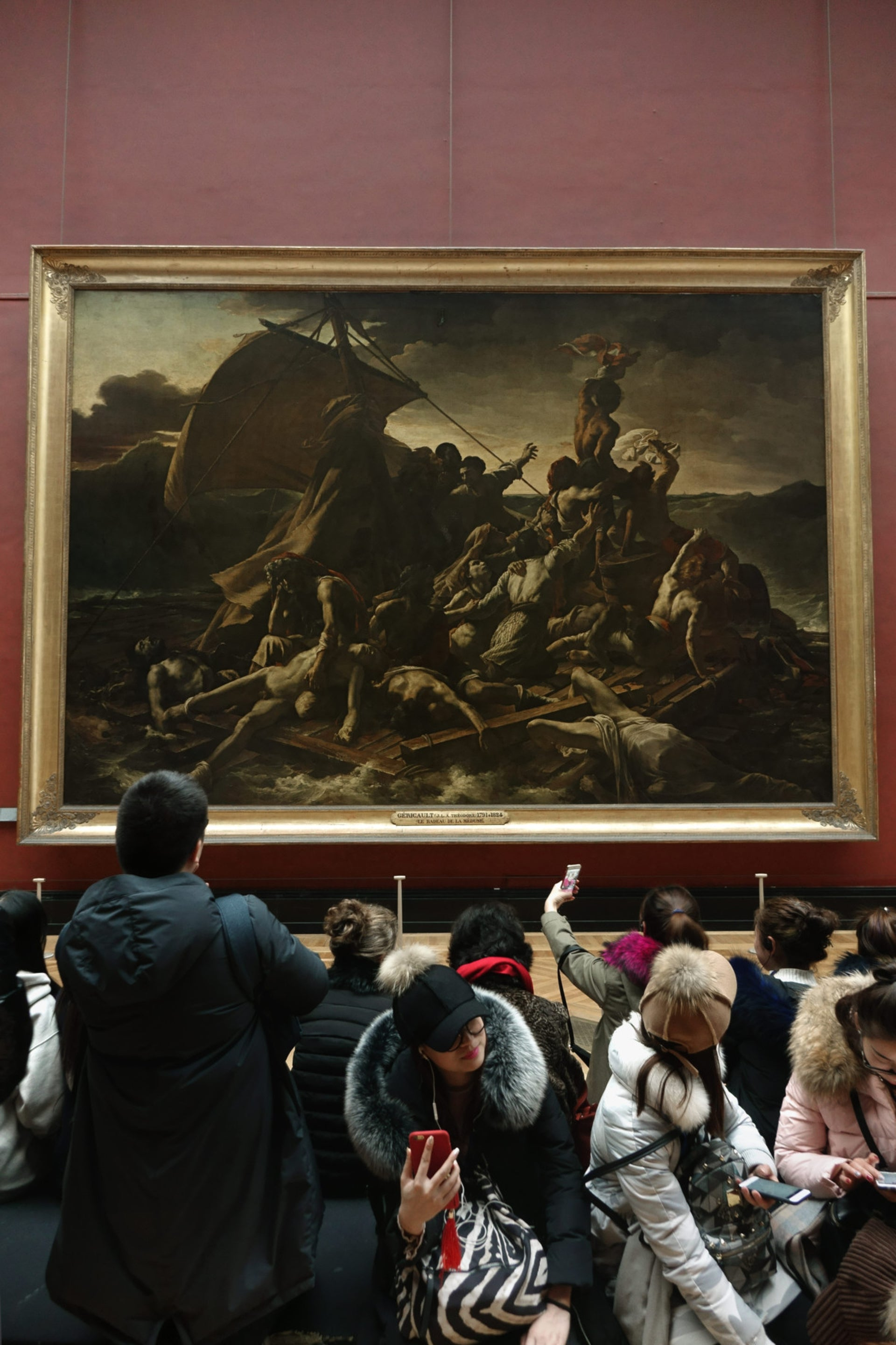 Visitors at the Louvre in Paris look at 'The Raft of the Medusa' by French Romantic painter and lithographer Théodore Géricault.