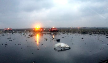 Russian emergency fire trucks are seen among the wreckage of a crashed plane at the Rostov-on-Don airport in Russia on Saturday, March 19, 2016.