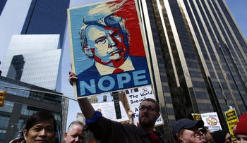 People rally as they take part in a protest against U.S. Republican presidential front-runner Donald Trump in New York, March 19, 2016.
