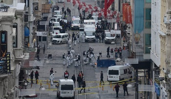 Turkish police, forensics and emergency services work on the scene of an explosion on the pedestrian Istiklal avenue in Istanbul on March 19, 2016.