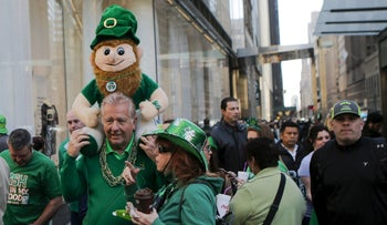 People gather around Times Square to celebrate the St. Patrick's Day parade in New York on March 17, 2016.