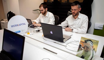 Ultra-Orthodox Jewish men work at a high tech start-up in an office in Tel Aviv. March 15, 2016
