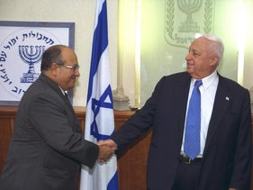 Prime Minister Ariel Sharon, right, congratulating Meir Dagan, the incoming Mossad chief, at a ceremony held at the Prime Minister's Office in Jerusalem, October 30, 2002.