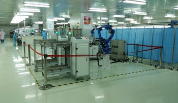 State of the art manufacturing by robot at the T&F plant in Dongguan, Shenzhen: This is an example of the direction China would like its industry to go - making smarter products using smarter processes.