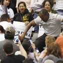 A member of the audience (R) stomps on a protester as Republican Presidential candidate Donald Trump speaks during a campaign event in Tucson, Arizona March 19, 2016.