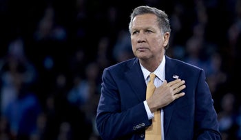 Republican presidential candidate John Kasich gestures while arriving to speak at AIPAC, March 21, 2016.