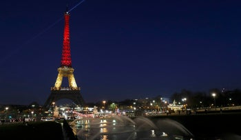 The Eiffel Tower is seen with the black, yellow and red colors of the Belgian flag in tribute to the victims of today's Brussels bomb attacks, Paris, France, March 22, 2016.