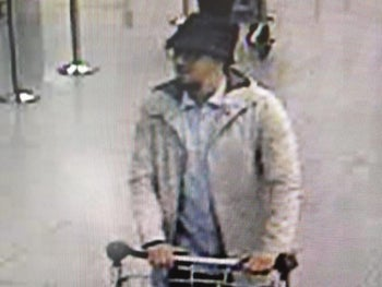 In a photo provided by the Belgian Federal Police, a man is shown who is suspected of taking part in the attacks at Belgium's Zaventem Airport and is being sought by police, March 22, 2016.