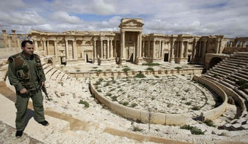 A Syrian policeman patrols the ancient oasis city of Palmyra, 215 kilometers northeast of Damascus, Syria, March 14, 2014.