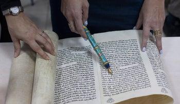 A woman reading the Megillah (Book of Esther).