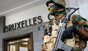Police control the access to Brussels central train station following Tuesday's bomb attacks in Brussels, Belgium, March 23, 2016.